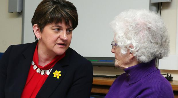 Arlene Foster speaks to pensioner Jean Ferguson at the Luncheon Club in Newbuildings Community Centre at the weekend