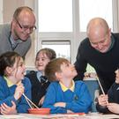 Oisin Mac Eo (left), of Gaelscoil na Daroige, and Nick Tomlinson, from Groarty Integrated Primary, with some pupils
