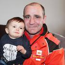 Hero postman Darren Dixon with little Caleb Campbell