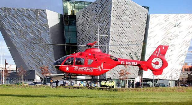 One of the two helicopters which will deliver Northern Ireland's helicopter emergency medical service, outside Titanic Belfast (Press Eye/PA)