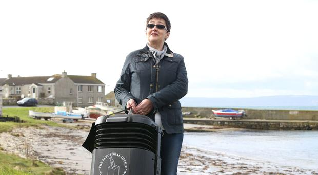 Senior presiding officer and polling station manager Teresa McCurdy on Rathlin Island, with the ballot box in which just over 100 people will cast their votes during the Assembly election