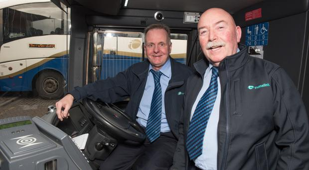 Foyle Street-based Translink bus drivers Noel Christy (left) and Johnny McLaughlin, who have 80 years of service between them