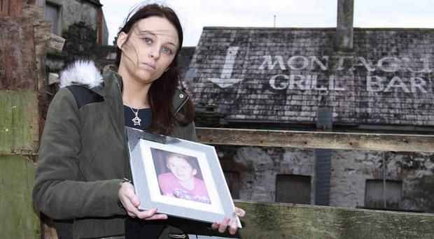 Laura Connor at the back of Montague Arms in Portstewart were the late Christopher Connor was found dead four years ago. PICTURE MARK JAMIESON.