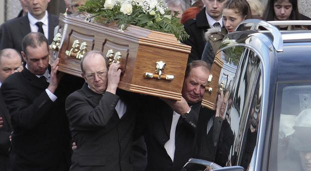 Family members of Jill Elder (43) carry her coffin from her Kilrea on Wednesday afternoon.