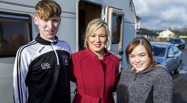 Sinn Fein leader in Northern Ireland Michelle O'Neill with her son Ryan and daughter Saoirse outside of St Patrick's Primary School in Clonoe