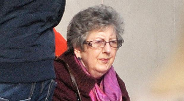 Ruth Colvin arriving at Belfast Crown Court yesterday in a wheelchair