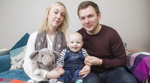 Much loved: Simon and Alanna Salter and son Theo. The elephant toy was a teddy that belonged to Isobel, their stillborn baby daughter