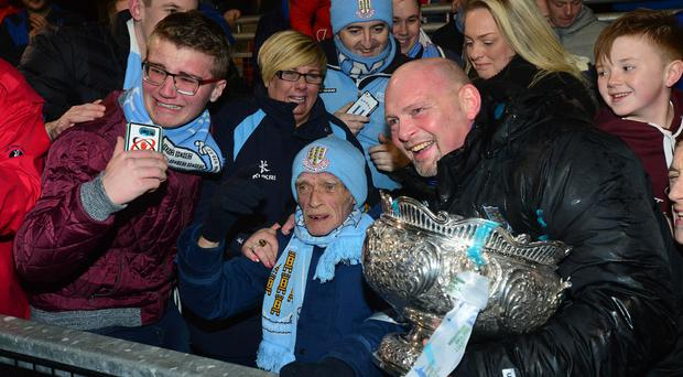 Ballymena United manager David Jeffery (right) celebrates with life long fan Trevor Burns (centre) after the club won the League Cup at Seaview last month