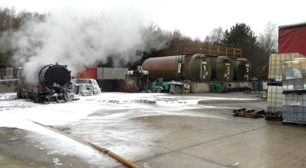 The aftermath of the fire next to oil silos at a fuel recycling plant