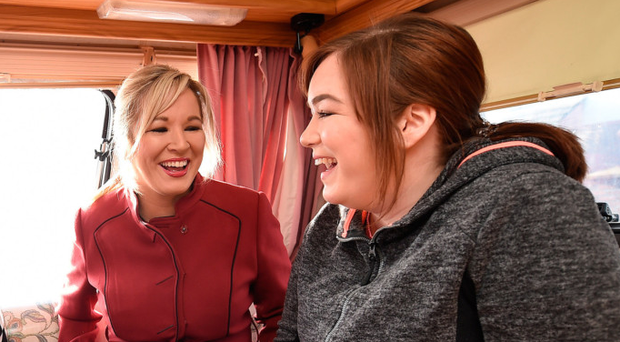 Michelle O'Neill jokes with her children Ryan and Saoirse as they sit in an election caravan parked outside Clonoe polling station. (Photo by Charles McQuillan/Getty Images)