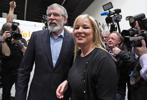 Sinn Fein president Gerry Adams celebrates with the party's northern leader Michelle O'Neill yesterday