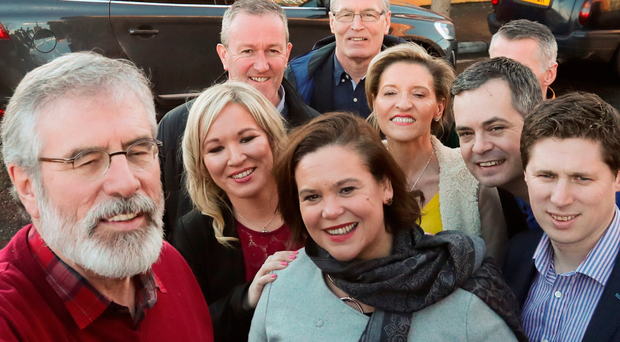Gerry Adams, Michelle O'Neill and Sinn Fein colleagues pose for a selfie in west Belfast on Saturday