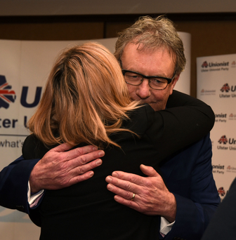 Mike Nesbitt hugs wife Lynda after announcing he was quitting as leader