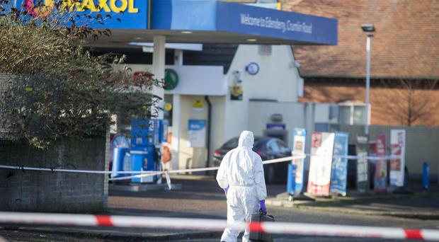 A forensic officer at the scene of the shooting