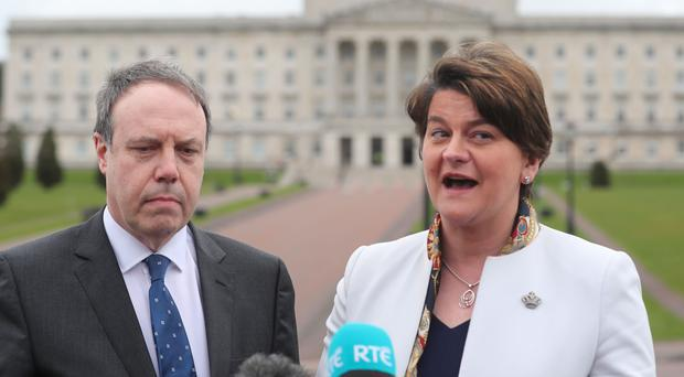 DUP leader Arlene Foster and deputy leader Nigel Dodds speak to the media outside Stormont in Belfast