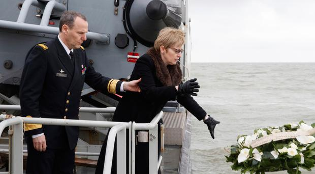 British ambassador to Belgium Alison Rose sends a wreath out to sea during a service for the victims of the Herald of Free Enterprise