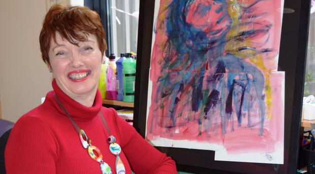Siobhan McQuade with some of her art that will be displayed at an exhibition in the Crescent Arts Centre to mark ovarian cancer month