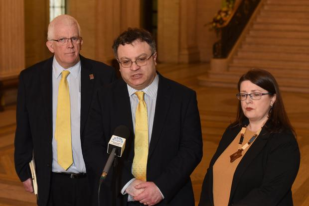 Alliance Party deputy leader Stephen Farry speaking to the media with party members Kellie Armstrong and Stewart Dickson