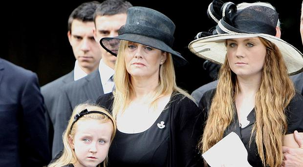 Brenda Hale (centre) at the funeral of her husband Captain Mark Hale in Hillsborough, Co Down, with her two daughters Alex (left) and Tori (right)