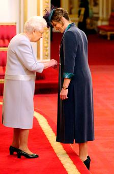 Sports star Katherine Grainger, who has won medals at the last five consecutive Olympics - a gold and four silvers - was presented with the honour by the Queen during a ceremony at Buckingham Palace
