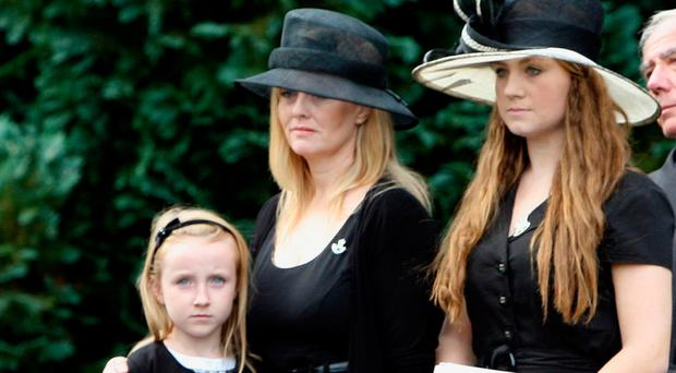 Brenda Hale and her daughters Alex and Tori at the funeral of her husband Captain Mark Hale in Hillsborough in 2009