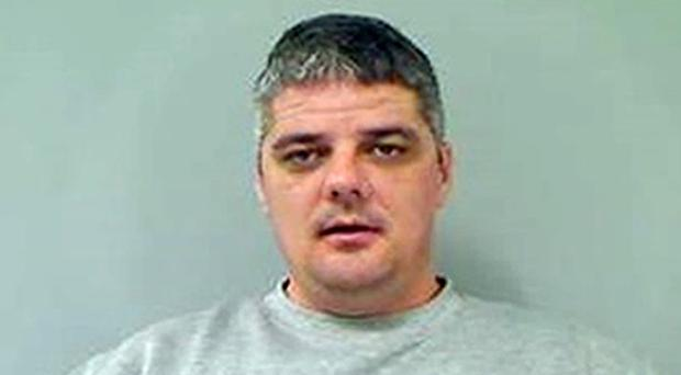 Michael Lawrence Smith is being hunted by Police in Northern Ireland (PSNI/PA)