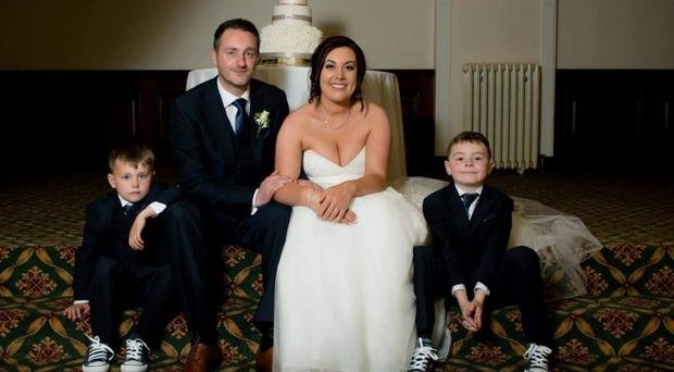 Lisa Robinson with husband Carl and sons Caiden and Callan