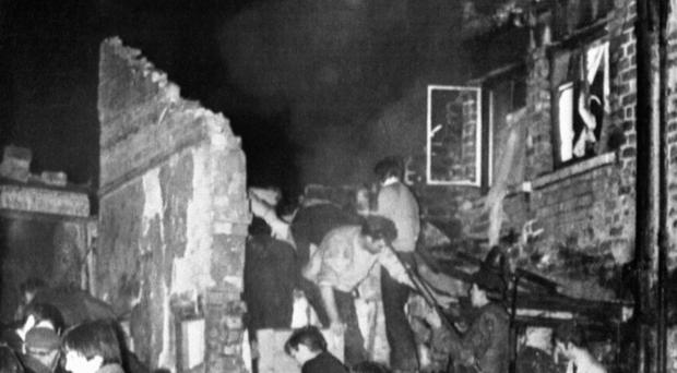 Rescuers dig in the rubble of McGurk's bar in North Queen Street, Belfast, where 15 people died in a bomb blast in 1971