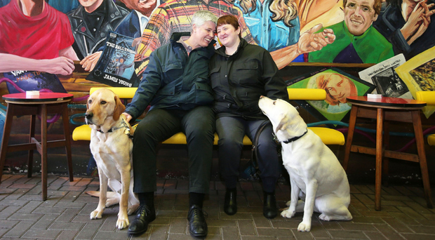 Andrea Hope and her partner Diane Marks with their guide dogs, Morris and Debbie