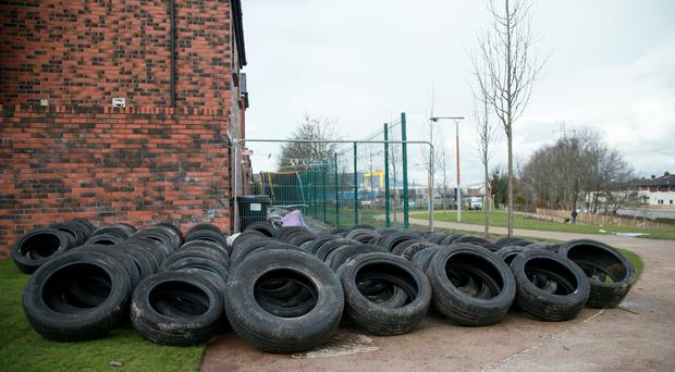 Wood pallets and tyres lie across the Flora Street section of the Comber Greenway in east Belfast, sparking calls to have them removed