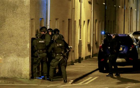 Officers raid a home in Portrush in the search for fugitive Michael Smith