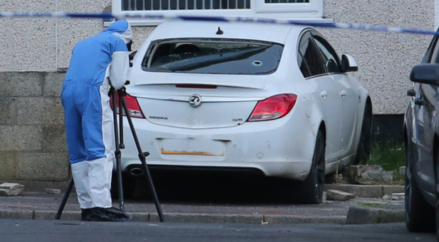 PSNI forensics officer at the scene of his shooting in Carrickfergus