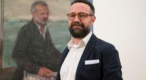 Gareth Reid with his portrait of Graham Norton, which was painted since the programme was recorded