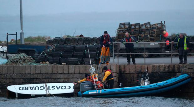 A piece of debris is towed into harbour on Tuesday night