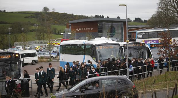 Lagan Pupils leave Lagan College yesterday during the security alert