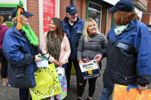 Street pastors Beth, Billy and Elaine talk to two students yesterday in the Holyland area of Belfast. The volunteers were out on the streets giving advice to revellers ahead of today's St Patrick's Day celebrations