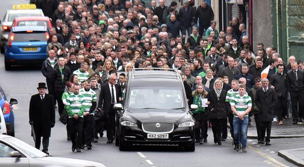 The funeral of Lurgan man Paul Curran makes its way along North Street in the town to St Peter's Church for Requiem Mass