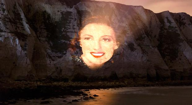 A portrait of Dame Vera Lynn in her early days is projected on to the White Cliffs of Dover to celebrate the 100th birthday of the popular wartime entertainer