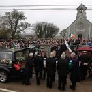 Hundreds of mourners look on as the coffin of Captain Dara Fitzpatrick arrives at St Patrick's in Glencullen