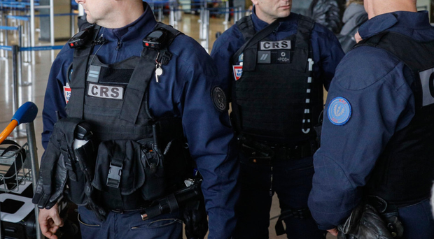 Riot police officers patrol inside Orly airport, south of Paris, at the weekendwhere