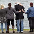 Family and friends gather on the slipway at the pier in Buncrana