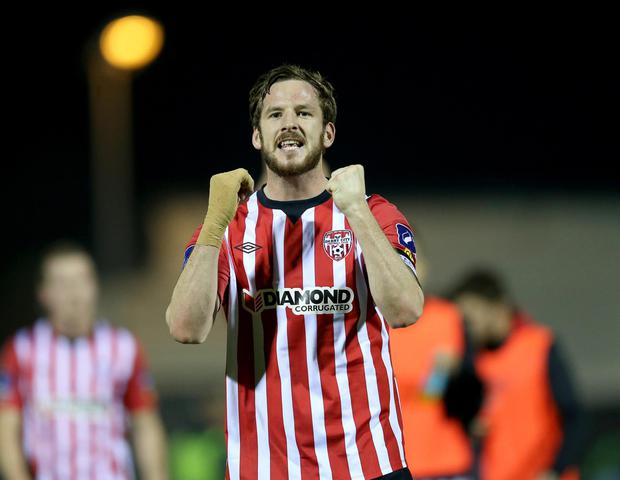 Ryan McBride in the thick of a match with his beloved club Derry City