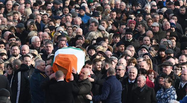 The coffin of Martin McGuinness is carried through the Bogside
