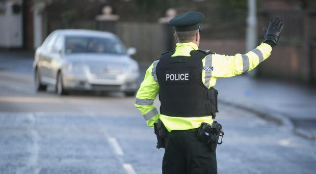 The PSNI said three officers escaped injury after they were targeted in an attack involving an explosive device in Strabane
