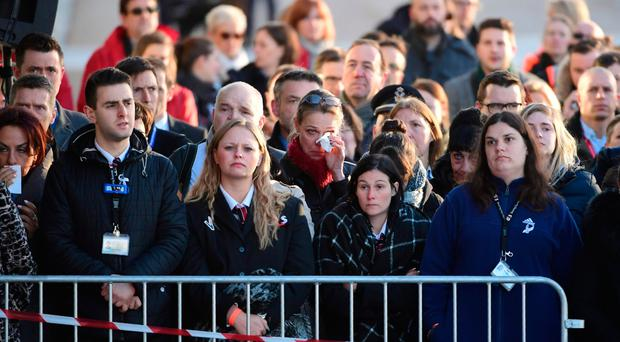 Employees at Brussels Zaventem Airport gather for a memorial ceremony to mark the first anniversary of the attacks by Islamic extremists