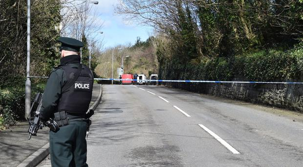 Police at the scene of the incident in Strabane
