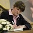 Arlene Foster signs the book of condolence at Stormont yesterday
