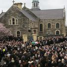 The coffin of Martin McGuinness is carried up Barrack Street ahead of his funeral at St Columba's Church Long Tower