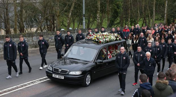 The funeral cortege of Derry City football captain Ryan McBride travels to the Long Tower church in Londonderry