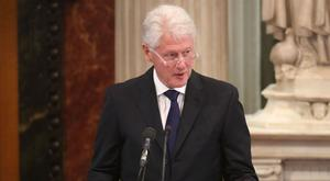 Former US president Bill Clinton addresses mourners